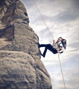Man climbing mountain w/ backpack